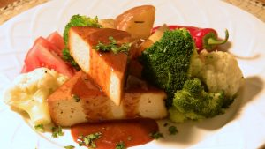 Tofu that has been marinated and grilled in orange sauce.