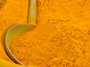 Abstract image of Indian tumeric powder from vegetable market.