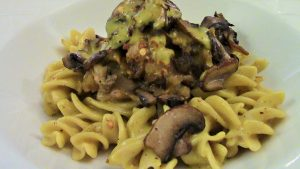 Smoked Coconut Curry Sauce over gluten free fusilli, with roasted and sauteed onions and eggplant. Topped with sauteed mushrooms.